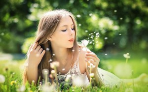 girl_blowing_dandelion